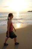 Woman on sunset beach Stock Image