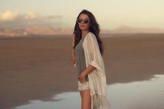 Woman at sunset beach Stock Photography