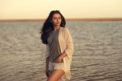Woman at sunset beach Royalty Free Stock Image