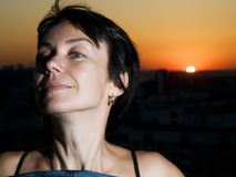 Woman and sunset in a city Royalty Free Stock Photography