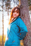 Woman in a sunset lights in autumn forest. Woman in a sunset lights in an autumn forest stock images
