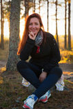 Woman in a sunset lights in autumn forest. Woman in a sunset lights in an autumn forest royalty free stock photos