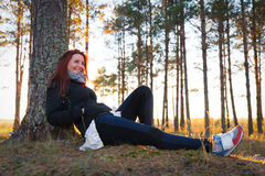 Woman in a sunset lights in autumn forest. Woman in a sunset lights in an autumn forest royalty free stock photography