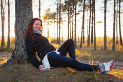 Woman in a sunset lights in autumn forest. Woman in a sunset lights in an autumn forest royalty free stock images