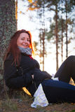 Woman in a sunset lights in autumn forest. Woman in a sunset lights in an autumn forest stock image