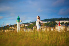 Woman at sunset on meadow near lighthouse in Deaville Royalty Free Stock Images