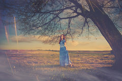 Woman at sunset meadow Royalty Free Stock Photography