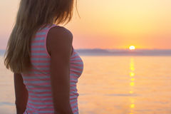 Woman sunset ocean Stock Images