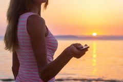 Woman sunset ocean Stock Image