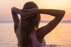 Woman sunset ocean Royalty Free Stock Photos