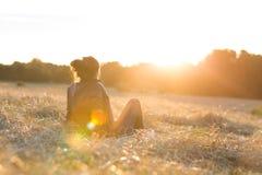 Woman at sunset stock photo