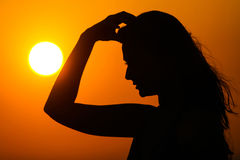 Woman at sunset Stock Photo