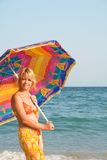 Woman with sunshade Stock Photos