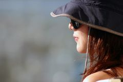 Woman in sunshine. An Asia young woman in sunshine with sun glasses Stock Photo