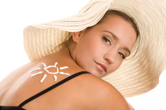 Woman applying sun cream Royalty Free Stock Photo