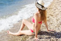 Woman with suntan Lotion on her back Stock Image