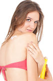 Woman with suntan lotion Royalty Free Stock Image