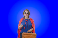 Woman superhero with red cape, blue. Stock Photos