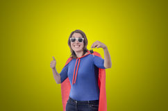 Woman superhero with a red cape and keys, green. Royalty Free Stock Images