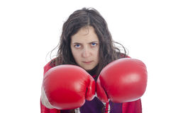 Woman superhero with red cape and red gloves boxing. Stock Images