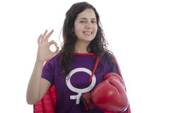 Woman superhero with red gesturing OK sign. Stock Images