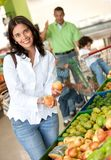 Woman at the supermarket Stock Image