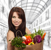 Woman in a supermarket Stock Images