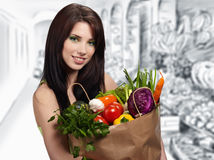 Woman in a supermarket Royalty Free Stock Images