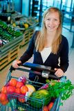 Woman in Supermarket Royalty Free Stock Photography