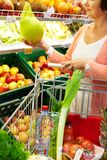 Woman in supermarket Royalty Free Stock Photos