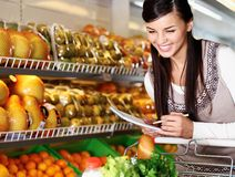 Woman in supermarket Royalty Free Stock Image