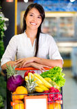 Woman at the supermarket Stock Images
