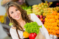 Woman at the supermarket Stock Photos