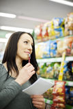 Woman in supermarket Stock Photography