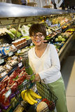 Woman in supermarket. Royalty Free Stock Photo