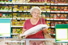 Woman at supermarket Stock Photography