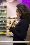 Woman in supermarket Stock Photo