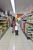 Woman with shopping cart in a Supermarket Royalty Free Stock Images