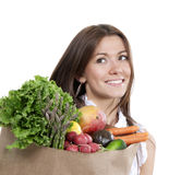 Woman with supermarket shopping bag full of groceries fruits and. Happy young woman with supermarket shopping bag full of groceries fruits and vegetables on Royalty Free Stock Images