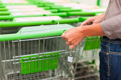 Woman in supermarket with shopping cart Royalty Free Stock Photography
