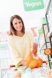 Woman at the supermarket Stock Photos