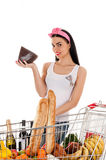 Woman with a supermarket trolley and cheese. In the hand Royalty Free Stock Image