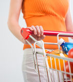 Woman at supermarket with trolley Stock Photography