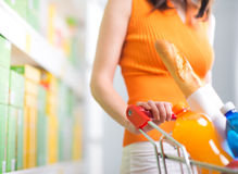 Woman at supermarket with trolley Royalty Free Stock Photography