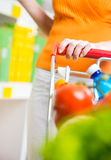 Woman at supermarket with trolley Stock Photo