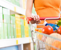 Woman at supermarket with trolley Royalty Free Stock Photo