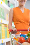 Woman at supermarket with trolley Royalty Free Stock Photos