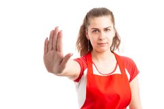 Woman supermarket worker making stop sign stock photo