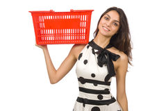 Woman with supermarkey basket Royalty Free Stock Images