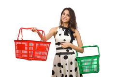 Woman with supermarkey basket Stock Image